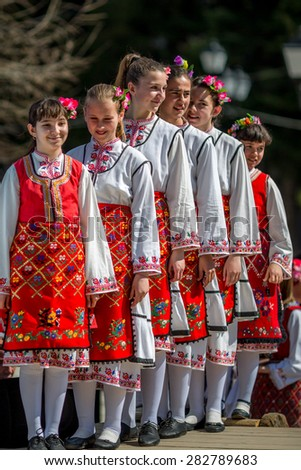 "RAZLOG, BULGARIA - APRIL 13, 2015: Female Bulgarian folklore dancers during the traditional folklore festival ""1000 national costumes"" - stock photo"