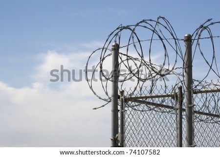 Razor Wire Chain Link Fence - stock photo