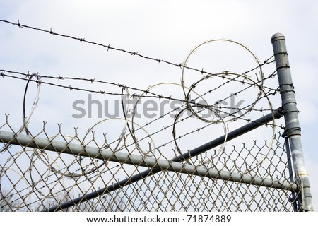 Razor Wire on Chain Link Fence - stock photo