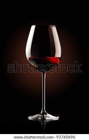 re wine glass on black background - stock photo