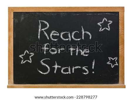 Reach for the stars written in white chalk on a black chalkboard isolated on white - stock photo