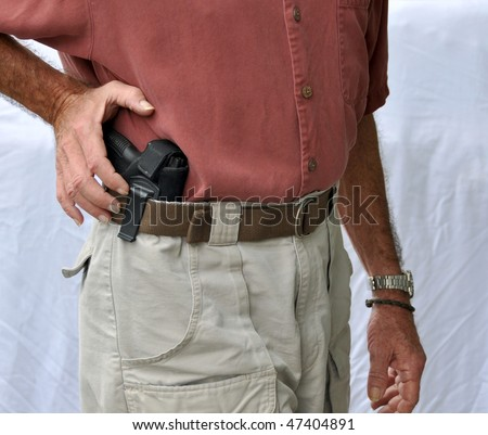 Reaching For Concealed Weapon - stock photo