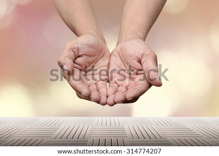 Reaching hand fine character design over blur background with wood pave - stock photo