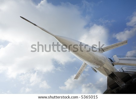 Reactive plane on a airfield - stock photo