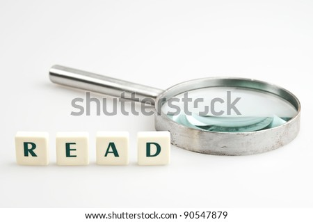 Read word and magnifying glass - stock photo