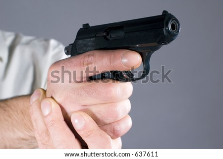 Readiness for shooting from a pistol - stock photo