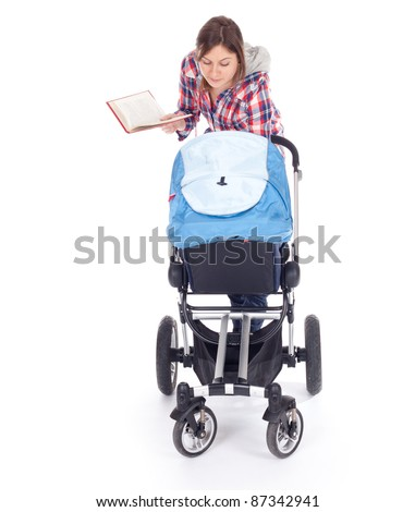 reading book young mother with baby buggy (stroller), white background - stock photo