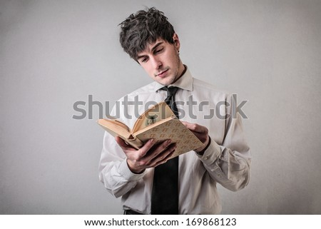 Reading Businessman - stock photo