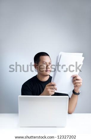 Reading documents - stock photo