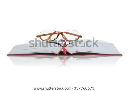 Reading Glasses on an Open Hardcover Book With Copy Space - stock photo