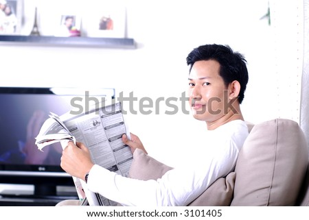Reading news paper looking for jobs - stock photo
