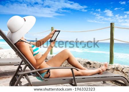 Reading on vacation - stock photo
