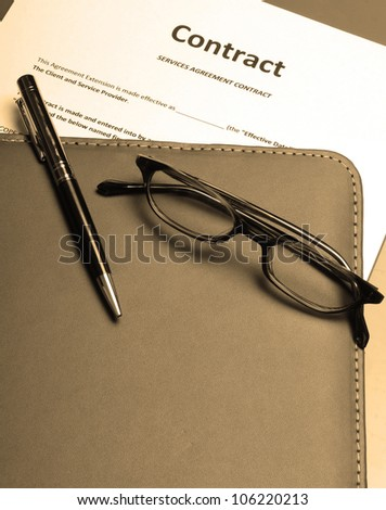 Reading over and a signing a business contract - stock photo