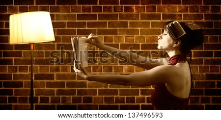 Reading with Floor lamp - stock photo