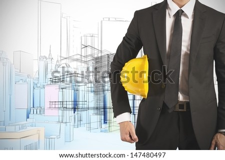 Ready businessman architect with yellow helmet - stock photo