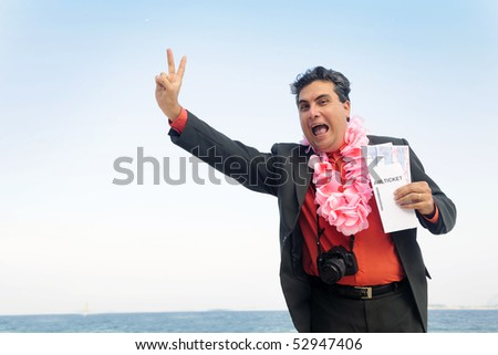 ready  for  a  holiday: businessman on the beach with air tickets - stock photo