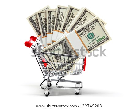 Ready for shopping - grocery cart full of stacks of dollar bills isolated on white  - stock photo