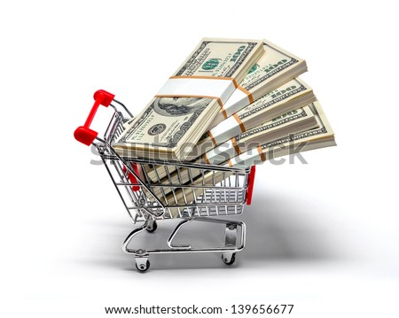 Ready for shopping - shopping cart full of stacks of dollar bills isolated on white - stock photo