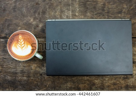Ready for work, Latte art coffee cup with notebooks computer on wood desk view from above - stock photo