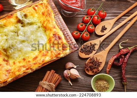 ready lasagna and its ingradent on a wooden table - stock photo