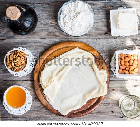 Ready made dough leaves, fillo, phyllo used for baklava, nuts and honey,Ingredients with Turkish dessert - stock photo