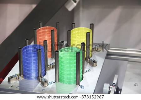 Ready plastic cover in the drive of injection molding machine - stock photo