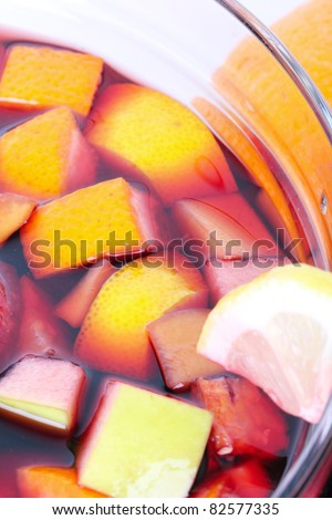 Ready sangria in glass bowl, closeup - stock photo