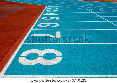 Ready, Set, Go! -- athletic surface markings using crumb rubbe - stock photo
