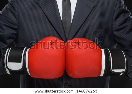 Ready to business battle. Close-up of businessman in red boxing gloves - stock photo