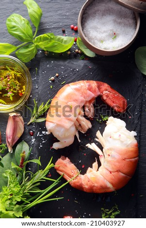 Ready to Cook Yummy Shrimp Meat with Other Ingredients on Side, on Black Wooden Platform - stock photo