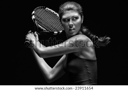 Ready to hit! Female tennis player with racket ready to hit a tennis ball. - stock photo
