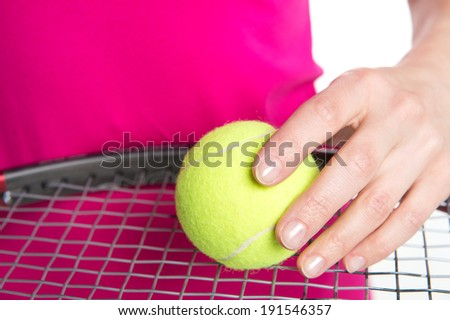 Ready to play. Tennis player holding a tennis ball and racket  - stock photo