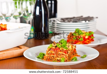 Ready to serve plate with lasagna. - stock photo
