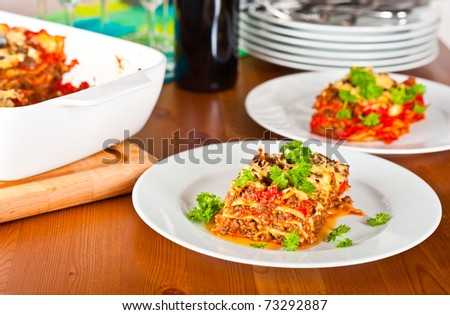 Ready to serve plate with lasagne. - stock photo