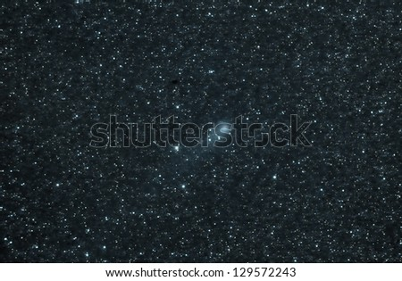 real astronomical picture taken by telescope of a comet. This one is known as Garrad and the picture was taken in 2009 - stock photo