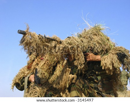 Real Camouflaged Soldier Aiming. Sniper - stock photo