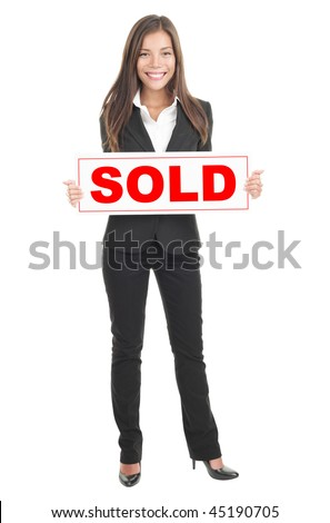 Real estate agent holding sold sign. Isolated in full length on white background. Mixed caucasian / chinese model. - stock photo