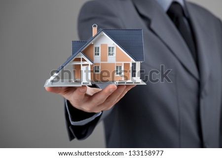 Real estate agent offer house represented by model. - stock photo