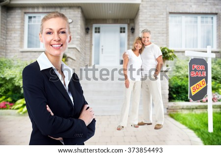Real Estate agent woman near new house. - stock photo