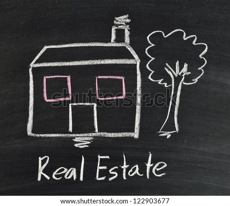 "real estate ""big house"" on blackboard - stock photo"