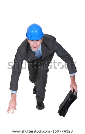real estate businessman ready to start a race - stock photo