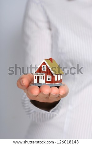 Real estate cocnept. Small house in female hands. - stock photo