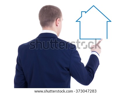 real estate concept - back view of young business man drawing house isolated on white background - stock photo