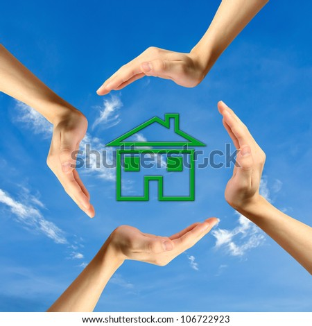 real estate concept. four hands around new house - stock photo