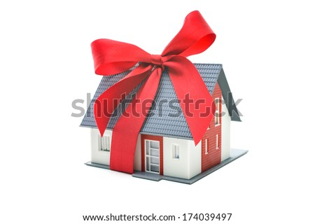 Real estate concept - house architectural model with red bow - stock photo
