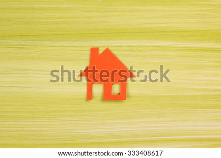 Real Estate concept. Model house, construction, house building. Top view. Paper house figure and blank business card on green wooden background. Top view. Copy space for text. - stock photo