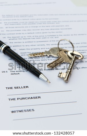 Real estate contract with pen and keys - stock photo
