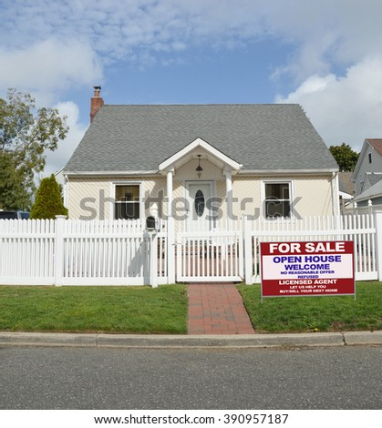 Real estate for sale open house (another success let us help you buy sell your  next home)  welcome sign Suburban Bungalow home White Picket Fence blue sky clouds Day Residential Neighborhood USA - stock photo