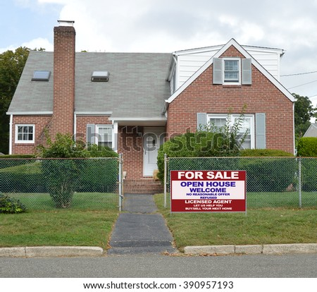 Real estate for sale open house (another success let us help you buy sell your  next home) welcome sign Suburban Brick Bungalow Home, Chain Link Fence Blue Sky Clouds Day Residential Neighborhood USA - stock photo