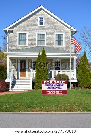 Real estate for sale open house welcome sign American flag pole Beautiful Gable style Suburban Home Sunny Autumn clear blue sky day residential neighborhood USA - stock photo